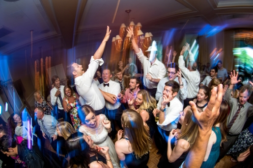 groomsmen-jump-into-the-air-while-celebrating-wedding-party-scaring-the-bride_t20_3wmEmA